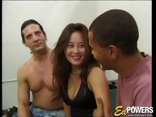 Sexy Asian babe has her first interracial triumvirate sex