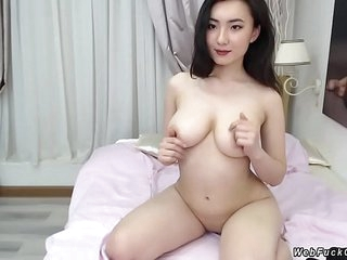 Inexperienced busty Asian camgirl posing