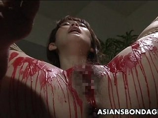 Asian babe get her private parts imperceivable in wax.