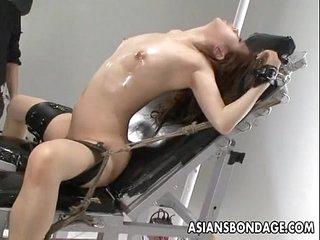Nasty Asian slut in bondage gets her detonate teased