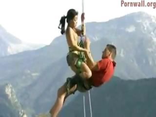 Adventurous couple hangs by trammels from a hot air fucking and sucking in a difficulty outdoors