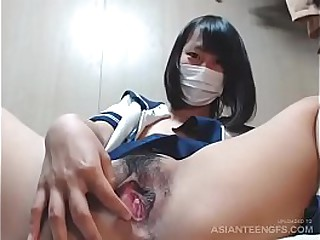 Slutty college chick from Japan exposes her twat on webcam