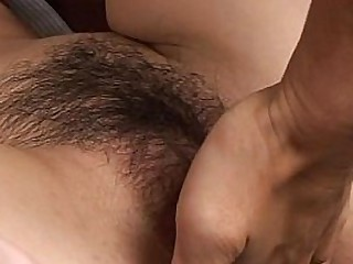 Asian descendant gets her hairy pussy fingered and toyed