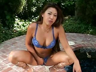 Asian girl is showing how she pisses on the ground on video