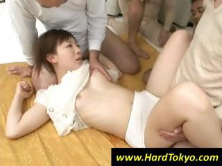Japanese girl is handy the mercy of four hard cocks fucking her