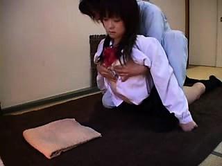 Ravishing Oriental teen has a masseur powerful his hands on